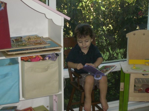 Isaac reading in hugh chair